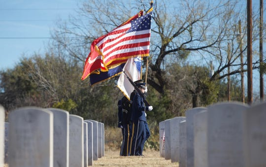A military honor guard attends a ceremony at Belvedere Memorial Park before wreaths are laid down beside the graves of veterans Saturday, Dec. 14, 2019 in San Angelo. The program is part of the nationwide Wreaths Across America event.