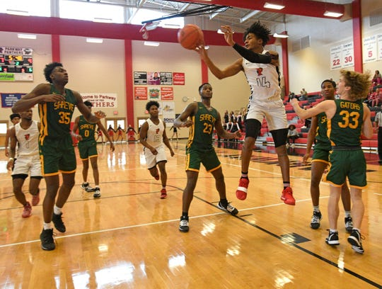 Parkway's Gabe Larry drives the lane for a bucket against Captain Shreve Saturday in the 2019 BFCU championship game.