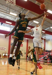 Captain Shreve's Kendal Coleman (35)  blocks a Parkway shot during Saturday's championship game of the 2019 BFCU tournament at Parkway.
