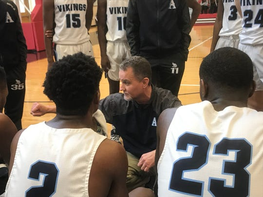 Airline coach Chris White gives instructions to his team during a timeout against Woodlawn Saturday afternoon in the 2019 BFCU tournament.