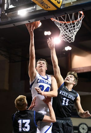 Ryder Kirsch of St. Thomas More makes a basket while West Lyon players attempt to block during the Barefoot Classic on Saturday, Dec. 14, at the Sanford Pentagon in Sioux Falls.