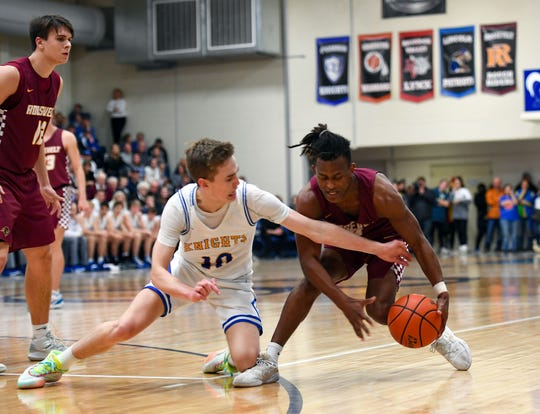 Jack Cartwright of O'Gorman attempts to steal the ball from Tyler Feldkamp of Roosevelt during their game on Friday, Dec. 13, at O'Gorman High School in Sioux Falls.