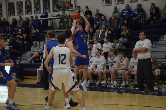 Baltic's Sam Sittig shoots over a Beresford defended on Friday, Dec. 13, 2019.