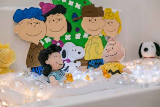 Snoopy and the gang take place of honor in the guest bath. Linda says her daughter came up with the idea for the bubble bath treatment.