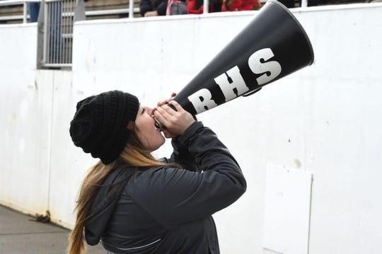 A Riverheads cheerleader tries to motivate the crowd during the Class 1 state football championship in Salem Saturday, December 14.