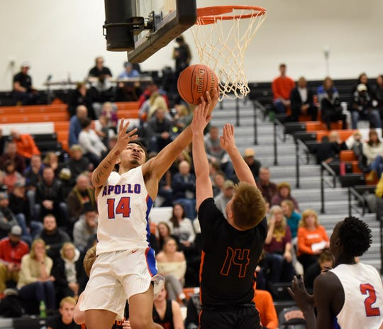 Apollo senior Jalyn Williams goes up for a layup Friday, Dec. 13, 2019, at Tech High School.