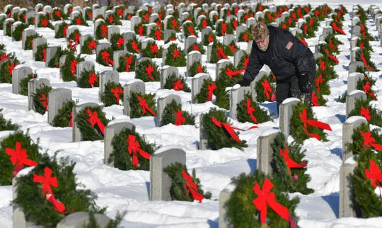 Veteran Richard McConnell pauses while placing wreaths on graves during the Wreaths for the Fallen ceremony Saturday, Dec. 14, 2019, at the Minnesota State Veterans Cemetery at Camp Ripley near Little Falls. Volunteers placed 5,958 wreaths, one for each grave, during the event.