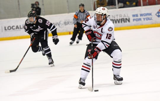 St. Cloud State senior defenseman Jack Ahcan controls the puck in Friday's NCHC contest against Nebraska-Omaha at the Herb Brooks National Hockey Center.