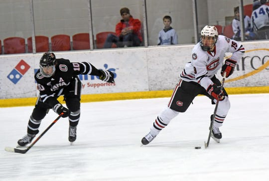 SCSU sophomore forward Sam Hentges looks to make a play against Nebraska-Omaha in Friday's NCHC battle at the Herb Brooks National Hockey Center.