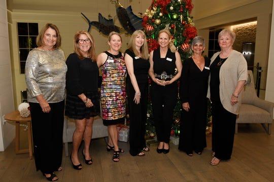 "Carol Houth, left, Andi Brennan, Ellen Houts, Kary Prueger, Kate Mikkelson, Diana Baker and Pat Garrett at Hibiscus Children's Center's ""Broadway at the Shores"" on Dec. 6, 2019, at Hutchinson Shores Resort & Spa, Stuart."