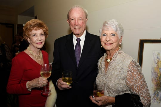 """Carrie Philipbar, left, Ron Daugherty and Joyce Haag at Hibiscus Children's Center's """"Broadway at the Shores"""" on Dec. 6, 2019, at Hutchinson Shores Resort & Spa, Stuart."""