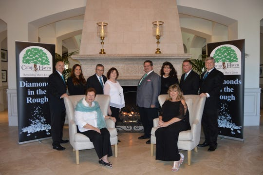 Jermey Gable, standing, from left, Brenda Sposato, Sam Nerses, Debbie Lewis, David Moshier, Brenda and Chuck Bradley and Brian Korkus with Linda Teetz, seated, and Pat Stelz.