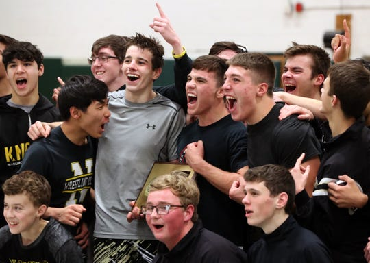 Nanuet celebrates after beating Pleasantville in the the Section 1 Dual Meet Wrestling Tournament Division II final at Pleasantville Dec. 13, 2019.