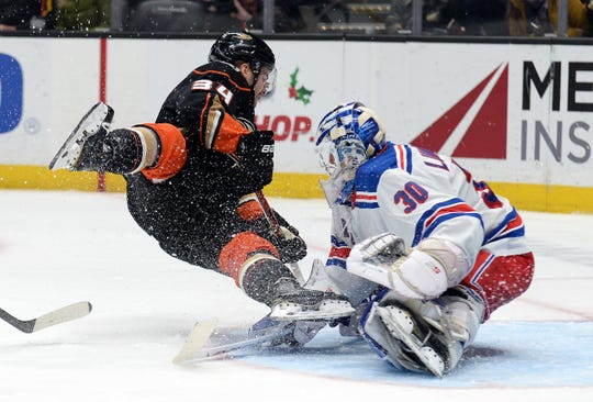 December 14, 2019; Anaheim, CA, USA; New York Rangers goaltender Henrik Lundqvist (30) blocks a shot as Anaheim Ducks center Sam Steel (34) collides during the second period at Honda Center. Mandatory Credit: Gary A. Vasquez-USA TODAY Sports