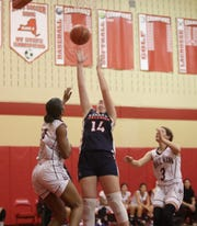 Kennedy Catholic's Erin Brann (14) puts up a shot during their 65-51 loss to Horace Mann (Bronx) in the championship round of the 24th annual Michael DePaoli Memorial Basketball Tournament at Somers High School on Saturday, December 14, 2019.