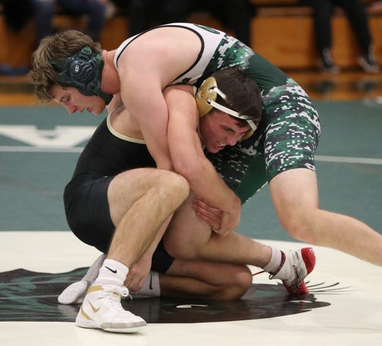 Nanuet's Chris Falborn, bottom, defeated Pleasantville's Joe Keating  in the 160-pound match at the Section 1 Dual Meet Wrestling Tournament Division II finals at Pleasantville Dec. 13, 2019. Nanuet won 42-39.