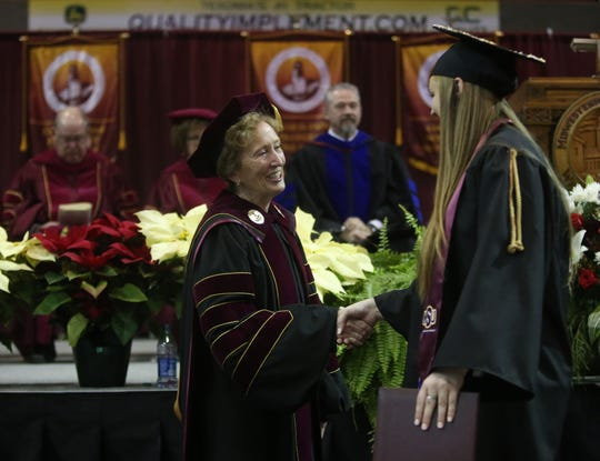 University President Suzanne Shipley congratulates a graduate at ceremonies for Midwestern State University, Dec. 14, 2019 at the Kay Yeager Coliseum. Photo by Bradley Wilson