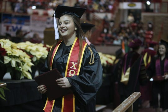Mia Heck walks across stage at graduation ceremonies for Midwestern State University, Dec. 14, 2019 at the Kay Yeager Coliseum. Heck received her bachelor of arts in mass communication. Photo by Bradley Wilson