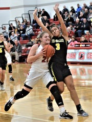 Sheridan's Kendyl Mick tries to drive on Tri-Valley's Kyndal Howe on Saturday, as the Scotties won 41-33. Both teams stayed in the top 10 in the Associated Press this week.