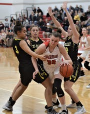 Sheridan's Faith Stinson is surrounded by Tri-Valley's Kyndal Howe (3), Lauren King (back) and Audrey Spiker (12) on Saturday, as the Scotties won 41-33.
