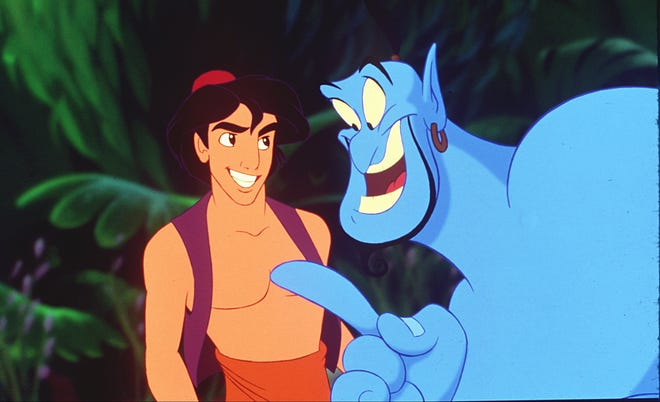 Aladdin and The Blue Genie of the Lamp confer in a scene from the Disney motion picture Aladdin.