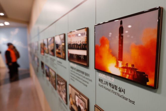 """In this Friday, Dec. 13, 2019, photo, an image showing North Korea's missile launch is displayed at the Unification Observation Post in Paju, South Korea, near the border with North Korea. North Korea on Saturday, Dec. 14, says it successfully performed another """"crucial test"""" as its long-range rocket launch site that would further strengthen its """"reliable strategic nuclear deterrent."""