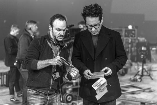 """Lifelong """"Star Wars"""" fans and co-writers Chris Terrio (left) and J.J. Abrams go over a scene on the set of """"The Rise of Skywalker."""""""