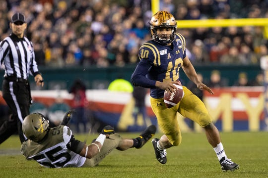 Navy quarterback Malcolm Perry set a rushing record while leading the Midshipmen to their first victory over Army after three losses.