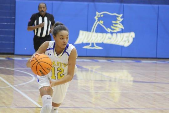 Wren's Raina McGowens drives toward the basket.
