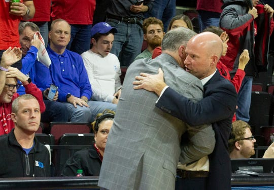 Coaches Steve Pikiell and Kevin Willard shake hands at end of game. Seton Hall Basketball at Rutgers in Piscataway, NJ on 12/12/19.