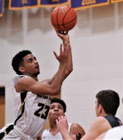 Abilene High's D.J. Modest (23) drives to the basket against Georgetown East View. The Eagles beat East View 64-38 at the Catclaw Classic on Saturday, Dec. 14, 2019, at Wylie's Bulldog Gym.