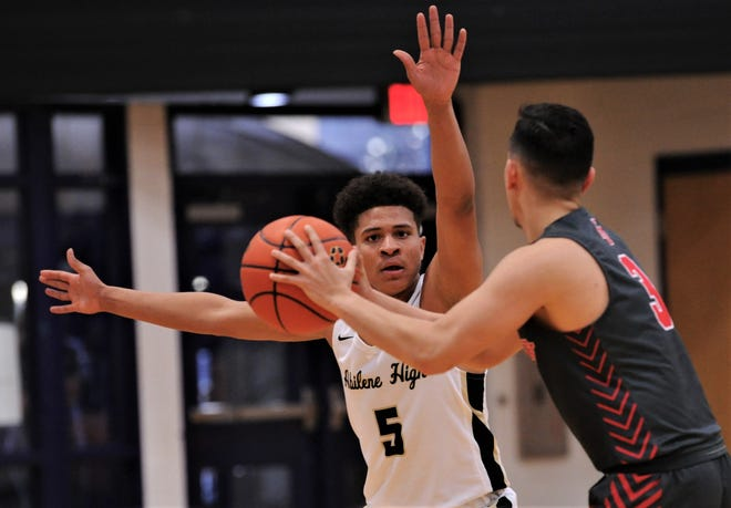 Abilene High's Khristian Johnson (5) defends against Georgetown East View's Jalen Newman in the second half. The Eagles beat East View 64-38 at the Catclaw Classic on Saturday, Dec. 14, 2019, at Wylie's Bulldog Gym.