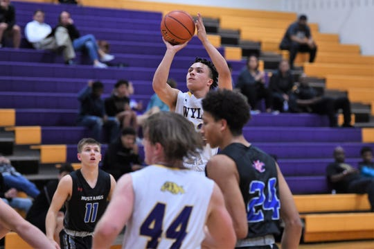 Wylie's Shayden Payne (22) takes a shot against Midland Christian during the Catclaw Classic finale at Bulldog Gym on Saturday. The Bulldogs fought before falling 47-43.