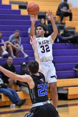 Wylie's Payton Brooks (32) takes a shot against Midland Christian during the Catclaw Classic finale at Bulldog Gym on Saturday. The Bulldogs fought before falling 47-43.