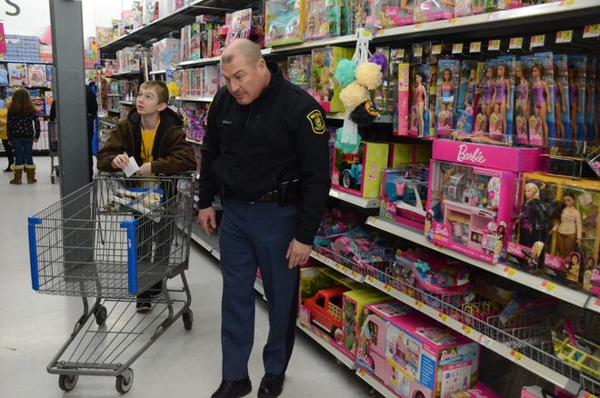 Trooper Steve Lamb of the Michigan State Police Post at Marshall looks for an item with Zackery Pelot, 13, of Battle Creek.