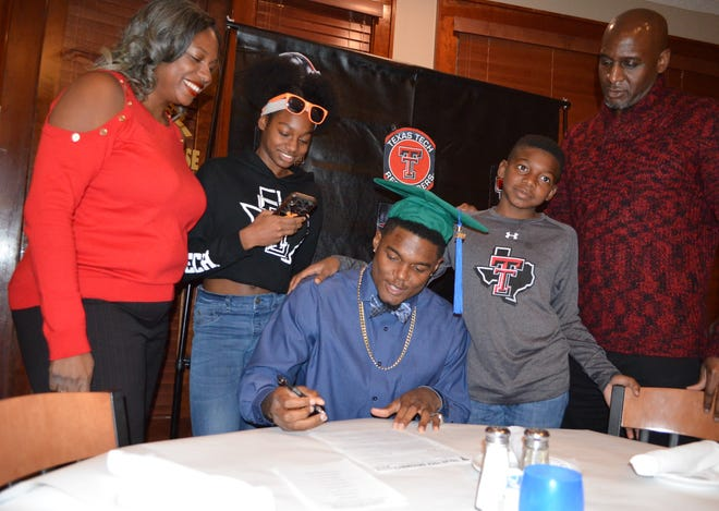 Former Battle Creek Central standout Brandon Bouyer-Randle, just hours after graduating from Michigan State University and still wearing his graduation cap, signs his National Letter of Intent play his senior year of football at Texas Tech.