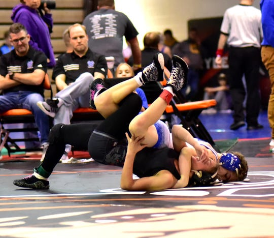 Spencer Moore of Walton-Verona scores a techfall win for the 106lb championship over Olivia Messerly of Ryle at the 2019 Ryle Raider Rumble, December 14, 2019.