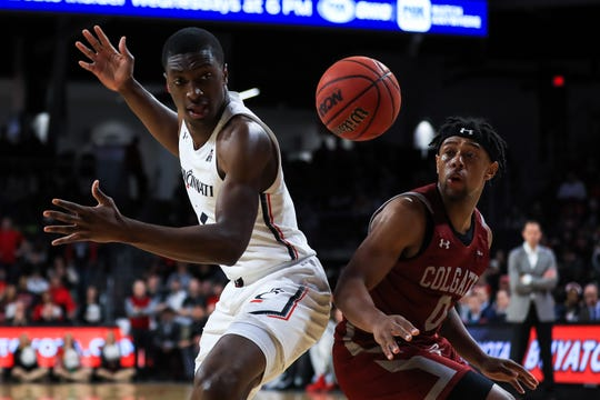 Dec 14, 2019; Cincinnati, OH, USA; Cincinnati Bearcats guard Keith Williams (2) loses the ball as he battles against Colgate Raiders guard Nelly Cummings (0) in the first half at Fifth Third Arena. Mandatory Credit: Aaron Doster-USA TODAY Sports