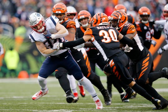 New England Patriots running back Rex Burkhead (34) breaks tackles on a run up the middle four a touchdown in the fourth quarter of the NFL Week 15 game between the Cincinnati Bengals and the New England Patriots at Paul Brown Stadium in downtown Cincinnati on Sunday, Dec. 15, 2019. The Bengals continued on their path to the No. 1 draft pick with a 34-13 loss to the Patriots.