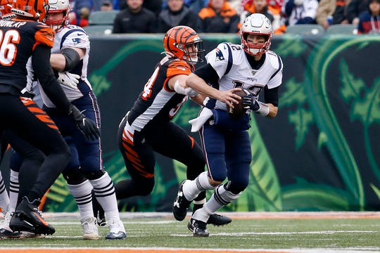 Cincinnati Bengals defensive end Sam Hubbard (94) gets a hard on New England Patriots quarterback Tom Brady (12) as he brings him down for a sack in the second quarter of the NFL Week 15 game between the Cincinnati Bengals and the New England Patriots at Paul Brown Stadium in downtown Cincinnati on Sunday, Dec. 15, 2019. The Patriots led 13-10 at the half.