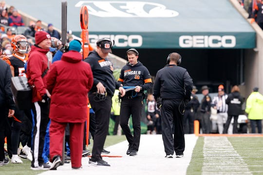 Cincinnati Bengals head coach Zac Taylor walks the sideline in the second quarter of the NFL Week 15 game between the Cincinnati Bengals and the New England Patriots at Paul Brown Stadium in downtown Cincinnati on Sunday, Dec. 15, 2019. The Patriots led 13-10 at the half.