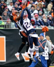 New England Patriots cornerback Stephon Gilmore (24) breaks up a pass intended for Cincinnati Bengals wide receiver Tyler Boyd (83) Sunday, Dec. 15, 2019, at Paul Brown Stadium in Cincinnati. The New England Patriots won 34-13.