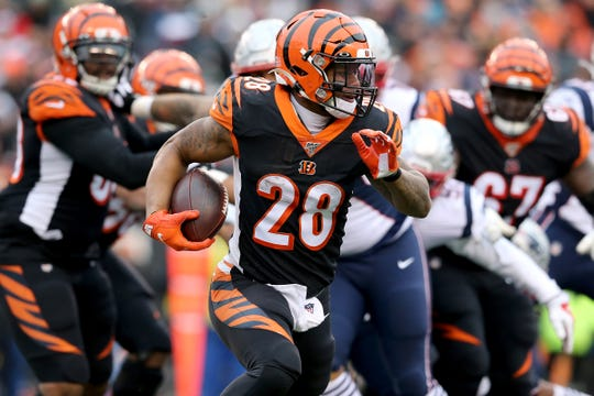 Cincinnati Bengals running back Joe Mixon (28) carries the ball during the third quarter of an NFL Week 15 game against the New England Patriots, Sunday, Dec. 15, 2019, at Paul Brown Stadium in Cincinnati. The New England Patriots won 34-13.