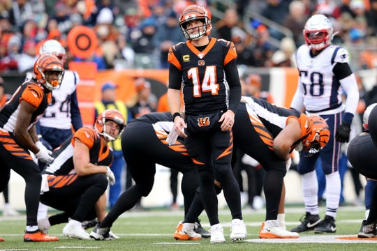 Cincinnati Bengals quarterback Andy Dalton (14) reacts after running down the play clock during the third quarter of an NFL Week 15 game against the New England Patriots, Sunday, Dec. 15, 2019, at Paul Brown Stadium in Cincinnati. The New England Patriots won 34-13.