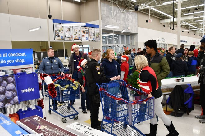 The Green Township Police Department and Police Citizens Academy took 103 kids Christmas shopping early Saturday morning