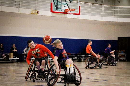 Members of the Rolling Panthers, a youth wheelchair basketball team based in Waterloo, run drills during Dec. 14.  AJ Fitzpatrick (left), 15, and Jayden Stafford, 13, have played together for the past five years.
