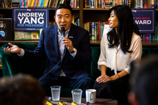 "Democratic presidential candidate Andrew Yang, left, and his wife Evelyn Yang speak during the, ""Family and Autism: An Honest Conversation,"" event, Saturday, Dec. 14, 2019, at Sidekick Coffee & Books in University Heights, Iowa."