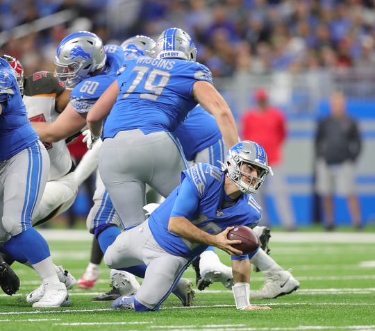 Lions quarterback David Blough (10) trips while handing the ball off during the first half on Sunday, Dec. 15, 2019, at Ford Field.