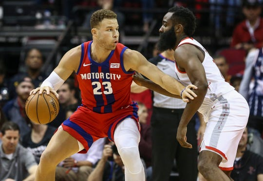 Detroit Pistons forward Blake Griffin dribbles against Houston Rockets guard James Harden during the first quarter Dec. 14, 2019, in Houston.