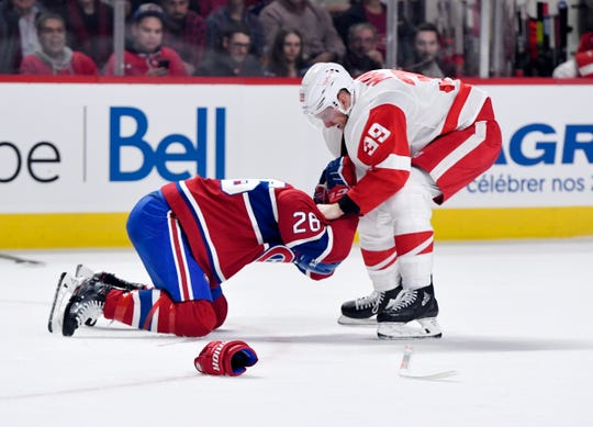 Detroit Red Wings forward Anthony Mantha fights with Montreal Canadiens defenseman Jeff Petry during the second period Dec. 14, 2019, in Montreal.